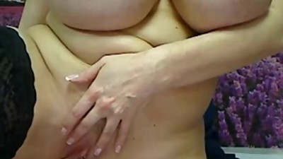 Busty MILF plays with her huge natural..