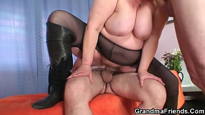 Huge grandma riding and sucking both..