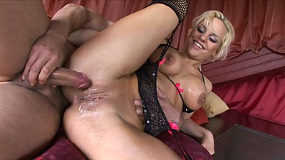 Hot blonde MILF sucks on two thick..