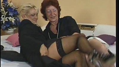Horny old red head fingers her pussy..