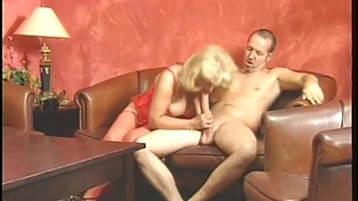 Mature blonde and brunette giving head..