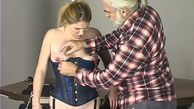 Cute young girl in corset has her..