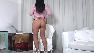 Big booty brunette teasing in fencenet..