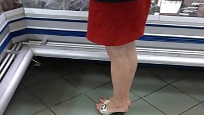 Candid Mature Feet in pums at the store