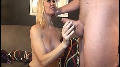 Sexy Milf Jerks Off A Naked Guy