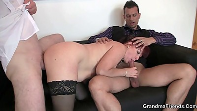 Lovely office lady enjoys two dicks at..