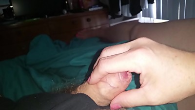 gently stroking my uncut foreskin cock