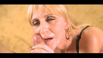 Blond cougar strips, sucks and gets a..