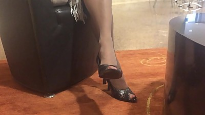 Mature nylon legs and heeled feet