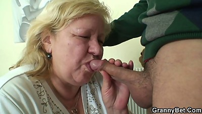 Huge granny tastes his cock then..